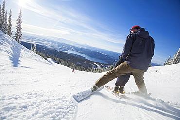 Father skiing with son (6-7), Whitefish, Montana, USA