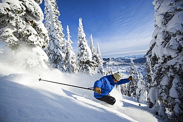 Man skiing in mountains, Whitefish, Montana,USA