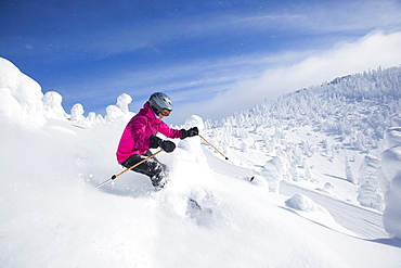 Woman skiing in mountains, Whitefish,Montana,USA