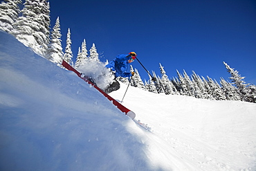 Man skiing in mountains, Whitefish,Montana,USA