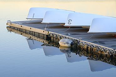 Overturned boats resting on dock, Boston, Massachusetts
