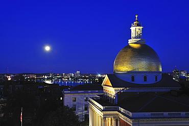 Massachusetts State House Dome and city skyline at dusk, Boston, Massachusetts