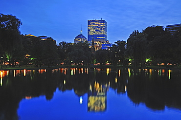Skyline of Copley Square Boston reflecting in pond of Public Gardens at dusk, Boston, Massachusetts