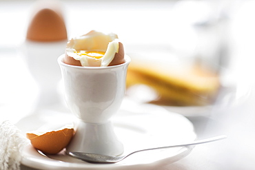 Close up of soft boiled egg in egg cup