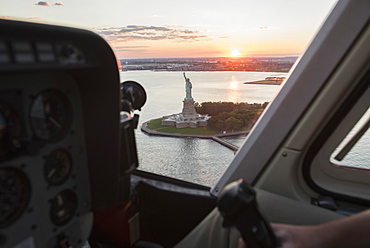 Cockpit in helicopter and Statue of Liberty, New York, New York