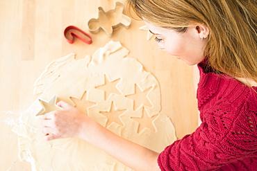 Young woman making coockies at christmas