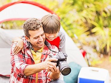 Father and son (12-13) using digital camera, Jupiter, Florida
