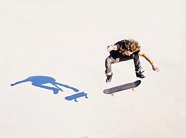 Man jumping on skateboard in skatepark, West Palm Beach, Florida