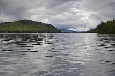 Scenic view of lake on cloudy day, Lake Placid, New York