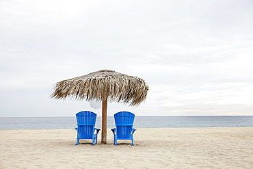 View of deckchairs on beach, Cabo San Lucas, Mexico