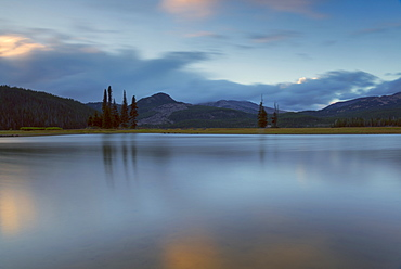Scenic view of lake and hills at dawn, Sparks Lake, Oregon