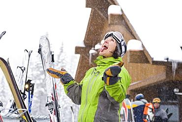 Portrait of woman enjoying snow, Whitefish, Montana, USA