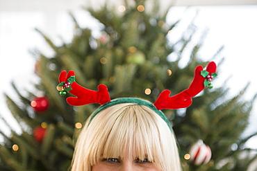 Blond woman wearing reindeer headband