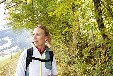 Woman hiking in mountains, Austria, Salzburger Land, Maria Alm