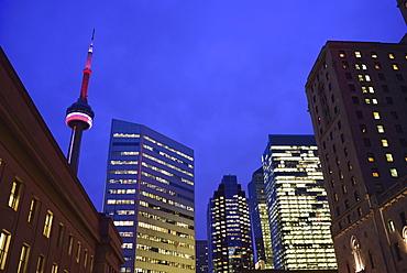 Illuminated city at dusk and CN Tower, Toronto, Canada