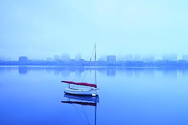 Charles River with boat shrouded in fog, Charles River, Boston, Massashusetts,USA