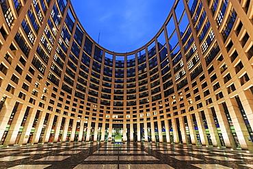 European Parliament building illuminated at dusk, European Parliament, Strasbourg, Alsace, France