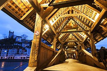 View along illuminated Spreuer Bridge, Spreuer Bridge (Spreuerbrucke) and city wall tower, Lucerne, Switzerland