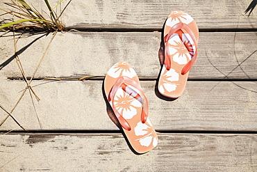 Flip flops on pier