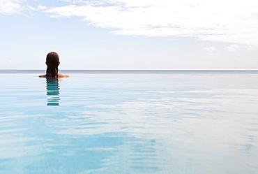 Woman in swimming pool, St. John, US Virgin Islands