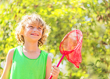Boy (8-9) holding butterfly net