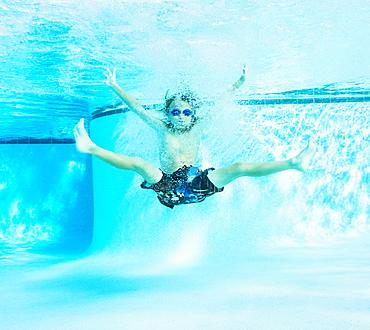 Portrait of boy (8-9) in swimming pool, Florida,USA