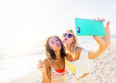 Female friends taking selfie on beach, USA, Florida, Jupiter