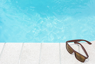 Sunglasses on pool side