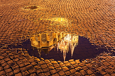Reflection of Erfurt Cathedral in puddle, Germany, Thuringia, Erfurt, Domplatz,Churches of St Severus,Cathedral of St. Mary Domberg