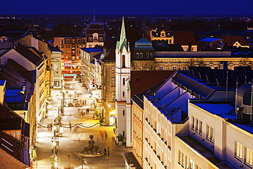 Illuminated old town street with tower of Schlosskirche, Germany, Brandenburg, Cottbus, Schlosskirche