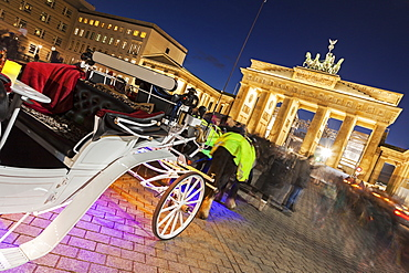 Horse carts in front of illuminated Brandenburg Gate, Germany, Berlin, Carriages on Pariser Platz, Brandenburg Gate
