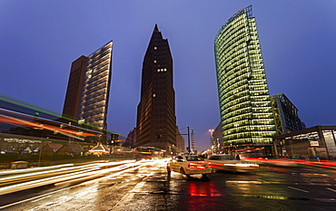 Illuminated skyscrapers and street traffic, Germany, Berlin, Potsdamer Platz