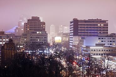Illuminated cityscape in fog, Germany, Berlin