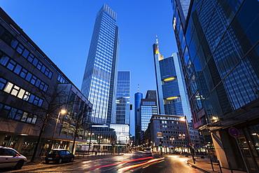Illuminated city street with skyscrapers, Germany, Hesse, Frankfurt