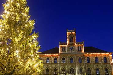 Illuminated Christmas tree and building facade, Germany, Thuringia, Weimar