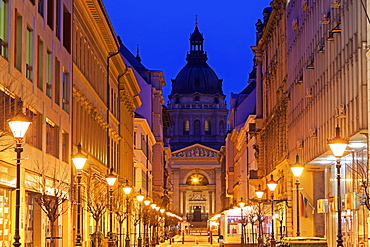 View along illuminated Zrinyi street, Hungary, Budapest, Saint Stephen's Basilica