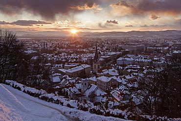 Winter cityscape at sunrise, Slovenia, Ljubljana, St. Florian's Church, St. James's Parish Church
