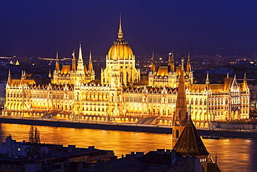 Hungarian Parliament illuminated at night, Hungary, Budapest, Hungarian Parliament,Protestant church, Fisherman's Bastion