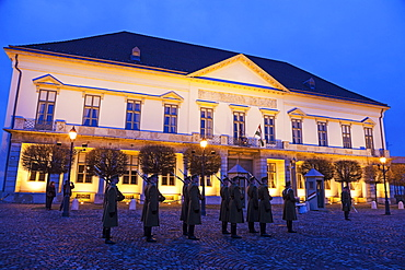 Honor guard in front of illuminated Sandor Palace, Hungary, Budapest, Sandor Palace