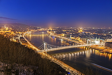 Waterfront cityscape with illuminated Elisabeth Bridge, Hungary, Budapest, Elisabeth Bridge, Chain Bridge