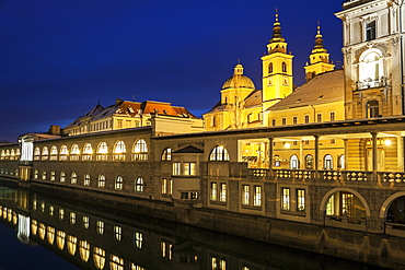 Illuminated waterfront with Saint Nicholas Cathedral, Slovenia, Ljubljana, Saint Nicholas Cathedral