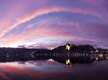 Clouds over Lake Bled and illuminated Church of the Assumption, Slovenia, Bled