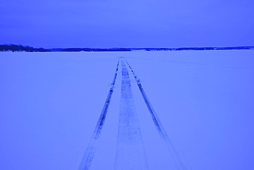 Snowmobile tracks on frozen lake, USA, New York State, Lake Champlain