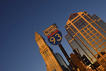 Road sign and office buildings at sunrise, USA, Massachusetts, Boston