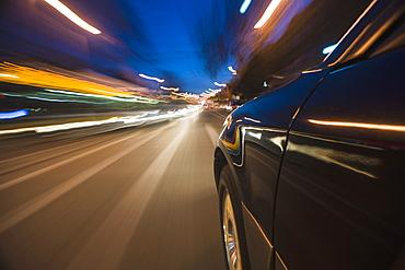 Car speeding through street, USA, Massachusetts, Boston