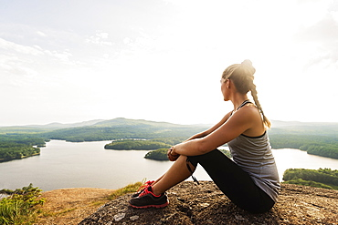Young female hiker looking at view, USA, Maine, Camden