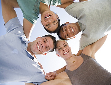 Multi-ethnic friends in huddle
