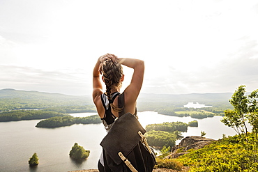 Rear view of young woman looking at lake, USA, Maine, Camden