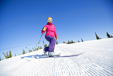 Woman skiing downhill, USA, Montana, Whitefish