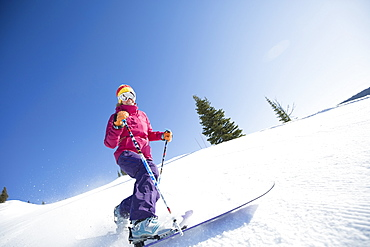 Woman skiing downhill, USA, Montana, Whitefish